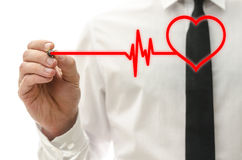 Cardiology concept. Drawing heart beating cardiograph on virtual screen royalty free stock photography