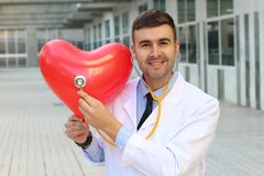 Cardiology concept with handsome doctor royalty free stock image