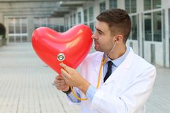 Cardiology concept with handsome doctor royalty free stock photos