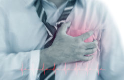 Cardiology. Front view of a businessman with cardiology heart disease, red around the area of pain Royalty Free Stock Images