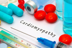 Cardiomyopathy. Diagnosis written on a white piece of paper. Syringe and vaccine with drugs stock images