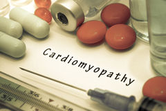 Cardiomyopathy. Diagnosis written on a white piece of paper. Syringe and vaccine with drugs stock photos