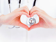 Cardioprotection. Closeup photo of doctor hands shaping a heart Stock Photo