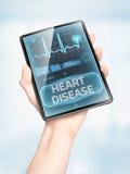 Cardiovascular disease. Vertical modern medical tablet displaying warning of cardiovascular disease Stock Photo