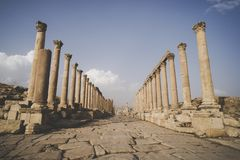 Cardo Maximus, the main street through ancient Jerash, - ruined, largest and most interesting Roman city. In Jordan royalty free stock image