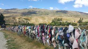 CARDRONA-NEW ZEALAND, JANUARY 2017: More than 7000 thousands bras at Cardrona bra fence, a touristic attraction also named royalty free stock image