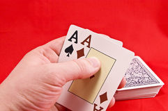Cards. In the hand on red Stock Image