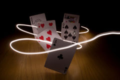 Cards. Five cards dancing in light Stock Photography