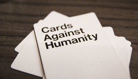 Cards Against Humanity. Enjoying a game of Cards Against Humanity Royalty Free Stock Photography