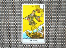 The Fool Tarot Card. This cards is about Beginnings, Void, Rebirth, Renewal, New Phase, Fresh,  Open to Change, Leap of Faith, Blind Faith, Convictions, and Royalty Free Stock Image