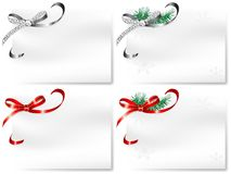 Cards with bows. Four blank cards with silver and red bows Royalty Free Stock Image