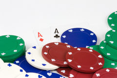 Cards and chips. Poker Chips and cards on white background Stock Image