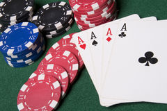 Cards and chips. Playing cards and several casino chips spread on a green poker table Stock Images