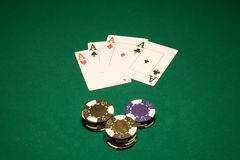 Cards and chips in casino. Four aces on the green table in casino Las Vegas stock photos
