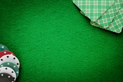 Cards and chips on green felt casino table. Abstract background Stock Images