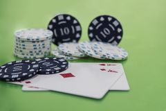 Cards and chips on green and yellow casino table. Abstract casino gambling photo royalty free stock photo