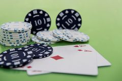 Cards and chips on green and yellow casino table. Abstract casino gambling photo stock images