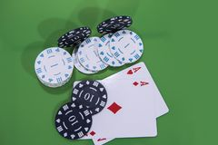 Cards and chips on green and yellow casino table. Abstract casino gambling photo stock photos
