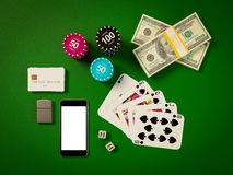 Cards and chips for poker on green table Stock Photography