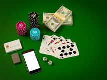 Cards and chips for poker on green table Stock Photos
