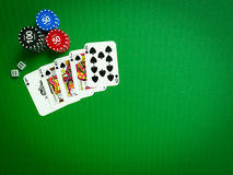 Cards and chips for poker on green table Stock Images