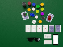 Cards and chips for poker on green table Royalty Free Stock Image