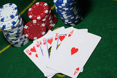Cards and chips for poker on green table, top view Stock Photos