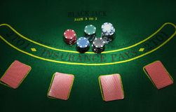 Cards and chips for poker on green table, top view Royalty Free Stock Photography