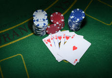 Cards and chips for poker on green table, top view Royalty Free Stock Photos