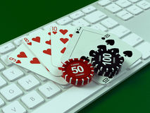 Cards and chips for poker on keyboard. Royalty Free Stock Photos