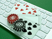 Cards and chips for poker on keyboard. Stock Photography
