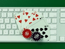 Cards and chips for poker on keyboard. Stock Photo