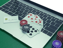 Cards and chips for poker on notebook. Stock Image