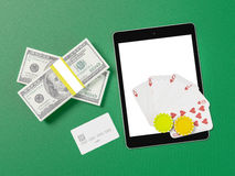 Cards and chips for poker on tablet. Stock Photo