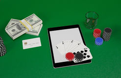 Cards and chips for poker on tablet. Royalty Free Stock Image