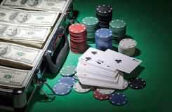 Cards, chips and suitcase of money on the green Royalty Free Stock Images