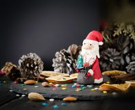 Cards Christmas figurine Santa Claus space for text, selective focus. Cards Christmas figurine Santa Claus Christmas THE BACKGROUND branches, cones, on a wooden Royalty Free Stock Photography