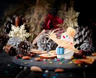 Cards Christmas figurine Snowman space for text, selective focus. Cards Christmas figurine Snowman BACKGROUND branches, cones, on a wooden table, space for text Royalty Free Stock Photo