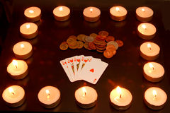 Cards,  coins & candles. Cards,  coins and candles isolated on black background Royalty Free Stock Photo