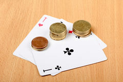 Cards and coins Royalty Free Stock Photos