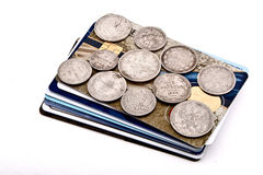 Cards coins. Old silver coins and credit cards Royalty Free Stock Photos