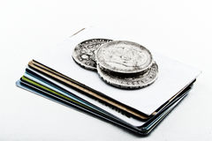 Cards coins. Old silver coins and credit cards Stock Photography