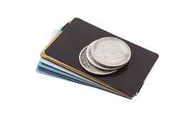 Cards and coins. Old silver coins are on the new credit card Stock Photos