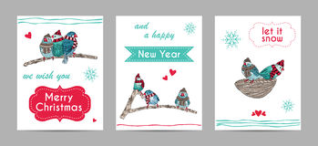 cards with cute birds warm dressed in winter season Stock Photo