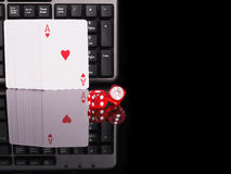 Cards, dice beside the keyboard. online card games concept Stock Photography