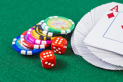 Cards, dice and poker chips Stock Photos