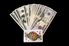 Cards and dollars. Cards and us dollars on black Royalty Free Stock Photos