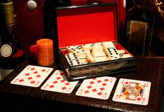 Cards and dominoes Royalty Free Stock Images