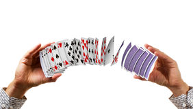 Cards fly between hands. Royalty Free Stock Image