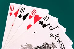 Cards four cards 10 10s joker.  Royalty Free Stock Photography